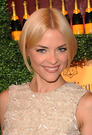Jaime King's flirty makeup look at the Veuve Clicquot Polo Classic involved a sweep of soft peach shadow across the lids and a pair of lengthy false lashes.