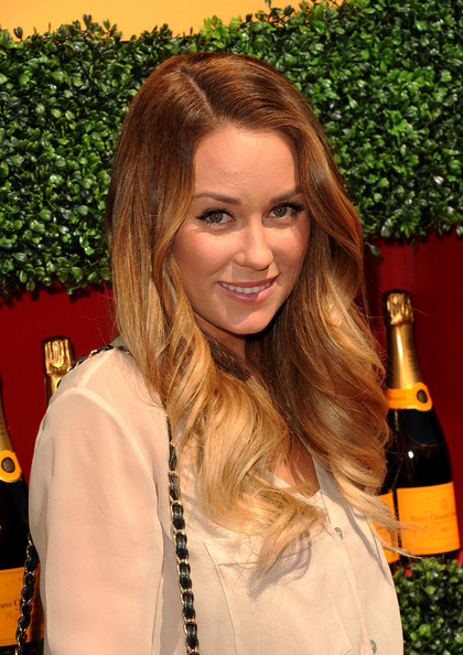 Lauren Conrad wore her long locks with a few waves at the Veuve Clicquot Polo Classic. She kept her look simple and causal for the daytime event.