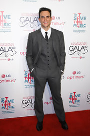 Cheyenne Jackson exuded old-world charm in a gray three-piece suit.