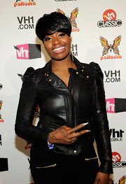 Singer Fantasia showed off her edgy style in a leather jacket and a side-swept bowl cut.