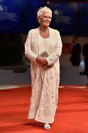 Judi Dench styled her look with a pair of strappy silver heels.
