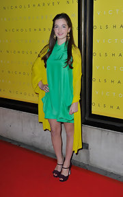 Celine Buckens wore low-key brown peep-toes with her vibrant outfit during Victoria Beckham's collection launch.