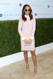 Ashley Madekwe styled her frock with a silver striped box clutch by Edie Parker.