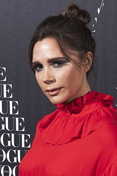 Victoria Beckham Hair Knot [vogue hosts a dinner,hair,hairstyle,eyebrow,forehead,chin,lip,black hair,neck,victoria beckham,honor,madrid,spain,santo mauro hotel,vogue,dinner]