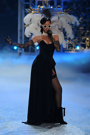 Rihanna looked dynamite on the V Secret runway in this black bustier gown with a hip-high slit.