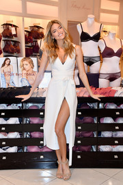 Martha Hunt was sweet and sexy at once in a low-cut, high-slit wrap dress at the new Body by Victoria collection launch.