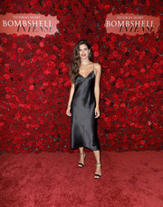 Sara Sampaio was boudoir-chic in a black slip dress at the Victoria's Secret Bombshell Intense launch party.