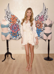 Romee Strijd looked quite the coquette in a white ruffle wrap dress while attending a Victoria's Secret event.
