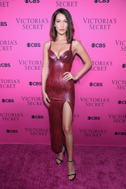 Bella Hadid enthralled in a red lace-print latex dress by Atsuko Kudo at the 2017 Victoria's Secret fashion show viewing party.