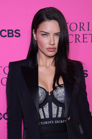 Adriana Lima layered a bedazzled corset top under a black tux for the 2017 Victoria's Secret fashion show viewing party.