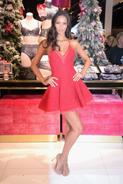 Lais Ribeiro celebrated the Victoria's Secret fashion show at the new 5th Avenue store wearing a flirty red skater dress.