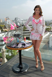 Miranda Kerr helped launch the Victoria's Secret 2012 swimwear collection wearing a pair of strappy platform sandals.
