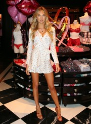 Romee Strijd was cute and flirty in a white heart-print wrap dress while promoting the new Victoria's Secret Dream Angels and Very Sexy collections.