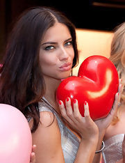 Adriana Lima wore a glossy cherry red nail polish at the Victoria's Secret Valentine's Day Event.