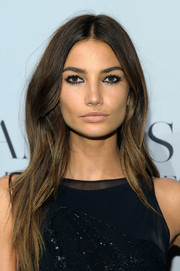 Lily Aldridge stuck to her signature center-parted style when she attended the 'Angel' book launch.