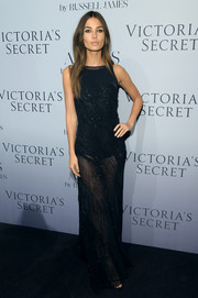 Lily Aldridge looked seductive in a beaded, sheer Donna Karan evening dress during the 'Angel' book launch.