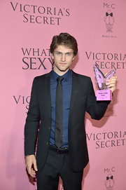 Keegan Allen looked handsome at the Victoria's Secret event wearing a sleek suit matched with a satin tie.