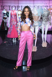Jasmine Tookes teamed pink satin pants with a floral crop-top for the Victoria's Secret Shop the Show event.