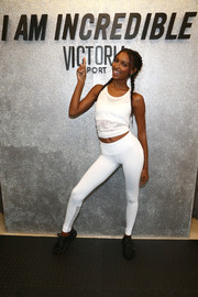 Jasmine Tookes matched her top with a pair of white leggings.