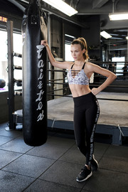 Josephine Skriver completed her sporty-sexy ensemble with a pair of black sneakers.
