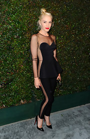 Gwen Stefani wowed at the video premiere of 'My Valentine' in a black mesh jumpsuit and pointy-toe stilettos.