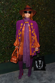 "Linda Ramone topped off her eccentric outfit with this patterned purple scarf at the premiere of Paul McCartney's ""My Valentine"" music video."
