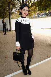 Miroslava Duma showed off her fine taste with a black exotic-skin Hermes Kelly.