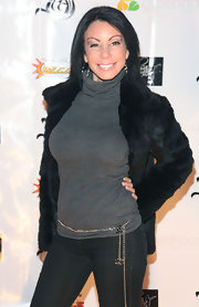 Danielle wears a sleek black fur coat over her gray turtleneck.
