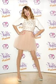 Martina Stoessel wore this romantic ivory and blush dress at the 'Violetta' photo call.