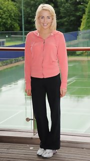 Lydia Bright kept it cool and casual in a pink cotton track jacket at the Virgin Active London Triathlon.