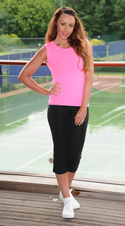Michelle Heaton posed at the Virgin Active Triathlon photocall for celebs in a pink tank and black leggings.