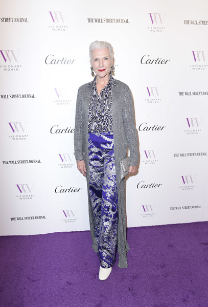 Maye Musk topped off her outfit with a long silver coat.