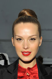Petra styled her hair in a high sleek classic bun for the Vivienne Tam fashion show.