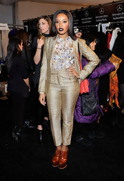 Angela Simmons' gold pant suit was both classy and sophisticated at the Vivienne Tam runway show.