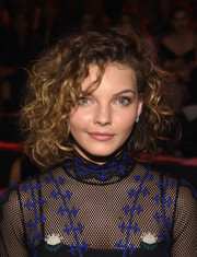 Camren Bicondova rocked a head full of curls at the Vivienne Tam fashion show.