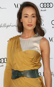 Maggie Q added an extra bit of flair to an already-stylish dress with an oversized teal belt.