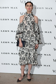 Erin O'Connor finished off her outfit with black ankle-tie pumps.