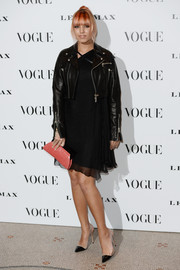 Amber Le Bon played with contrasts for her Vogue 100: A Century of Style look, teaming an edgy leather jacket with a flirty LBD.