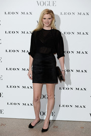 Lara Stone complemented her top with a black suede mini skirt.