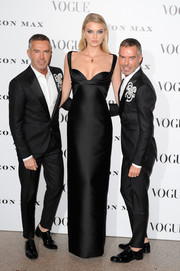 Lily Donaldson was sleek and statuesque in this black sweetheart-neckline column dress during the Vogue 100: A Century of Style event.