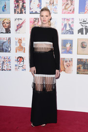 Lara Stone looked cool and modern at the Vogue 100 Festival Gala in a black-and-white Christopher Kane maxi dress with cutouts across the midriff and thighs.