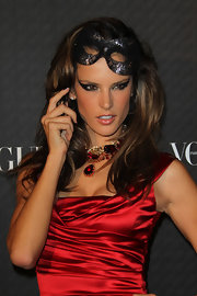 Alessandra showcased a sultry cat eye while attending Vogue's 90th Anniversary party.