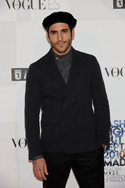 Miguel Angel Silvestre's dark gray pea coat and high-collar shirt had a charming retro appeal.