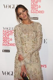 Eva Gonzales carried a small structured green clutch with gold lining at the 'Vogue' event.