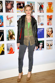 Georgia May Jagger simply has rocker style in her genes. Check out this rustic leather jacket with red lining.