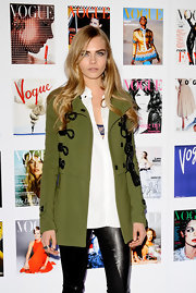 Cara Delevingne was seen at the Vogue Festival 2012 cocktail party wearing a green trenchcoat.