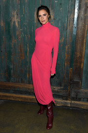 Victoria Beckham brightened up the Vogue Forces of Fashion conference with this fuchsia turtleneck sweater dress from her own line.
