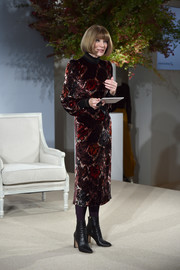 Anna Wintour showed off her fall style with this floral velvet midi dress by Marc Jacobs at the Vogue Forces of Fashion conference.