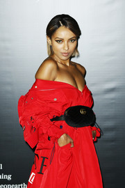 Kat Graham accessorized with a black velvet belt bag by Gucci at the Vogue Italia New Beginning party.