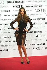 Izabel Goulart struck a fierce pose the a Vogue launch party in a daring black beaded dress.